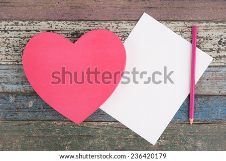 Heart gift box and paper on vintage wood table for background - stock photo