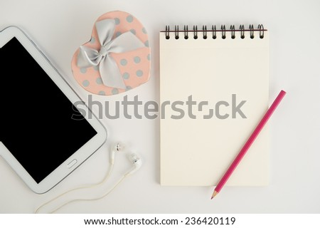 Heart gift box tablet and note book pencil on  white background - stock photo