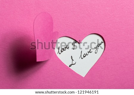 Heart Half-Cut From Pink Paper - stock photo