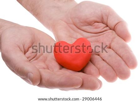 Heart held in hands - stock photo