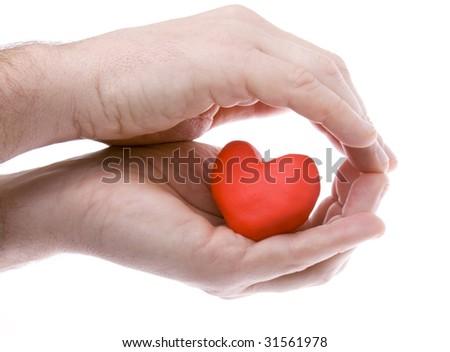 Heart hiding in hands - stock photo