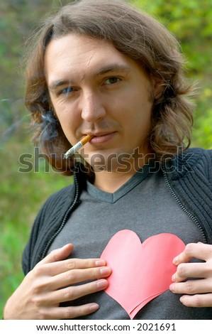 heart holding smoker - stock photo