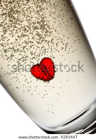 Heart in champagne flute. Isolated on white.