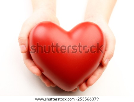 Heart in child hands isolated on white - stock photo