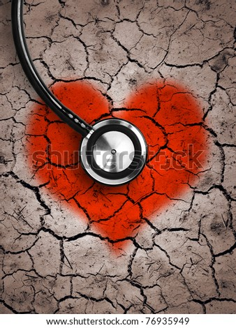 Heart in desert land and stethoscope - stock photo