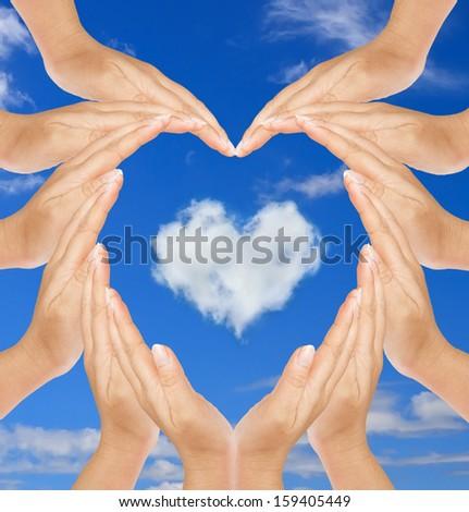 Heart in hand  heart-shaped cloud - stock photo