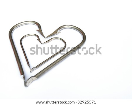Heart in heart in the fisherman's heart. White background with space for text. - stock photo