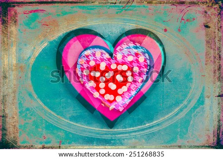 Heart in heart on a pastel grungy background - stock photo