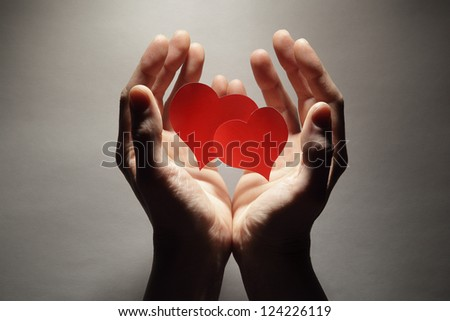 Heart in palm - stock photo