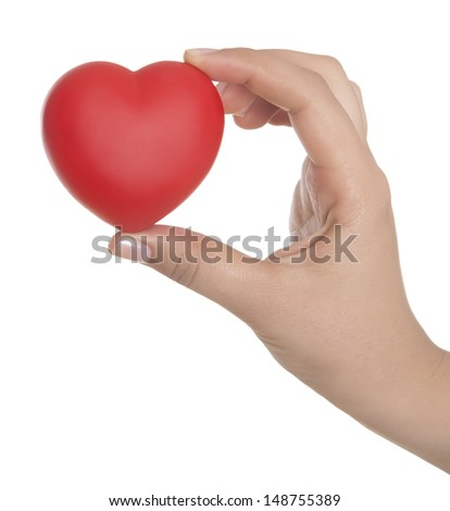 Heart in palms - stock photo