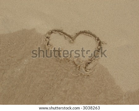 heart in sand with water