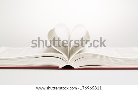 Heart in the form of sheets of the book, studio shot - stock photo