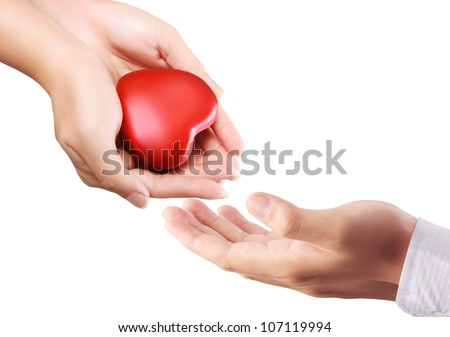 Heart in the hand isolated on white