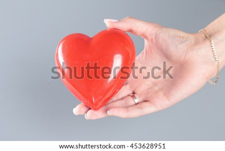 Heart in woman hand