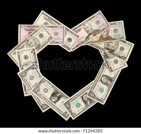Heart is laid out from dollars of various face value, isolated on a black - stock photo