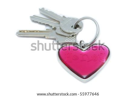 Heart keyring with keys isolated on white - stock photo