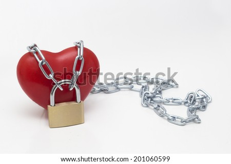 heart locked with chains, isolated on white - stock photo