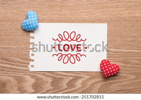 """Heart Love. Pink & Cyan heart with the word """"love"""" printed on paper note. Valentine's Day concept. Valentine Heart Card Design - stock photo"""