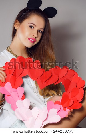 Heart. Love.  Portrait of beautiful woman hold Valentine day symbol. Isolated studio background female model. Beautiful girl. Valentines Day. Woman holding Valentines Day heart sign with copy space - stock photo