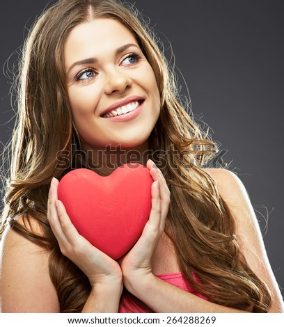 Heart love symbol. Face close up portrait. Young toothy smiling woman  hold heart. - stock photo