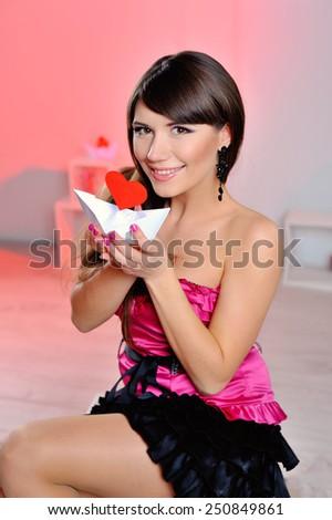 Heart. Love symbol. Portrait of beautiful happy woman hold Valentine day symbol. Beautiful girl.  - stock photo