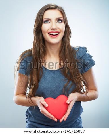 Heart. Love symbol. Portrait of beautiful woman hold Valentine day symbol. Isolated studio background female model. Beautiful girl. - stock photo