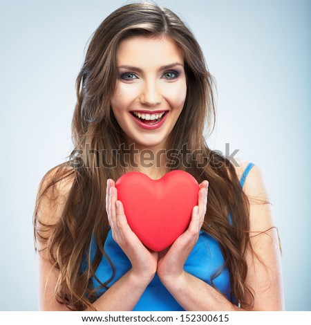 Heart, love symbol young happy woman hold. Isolated on studio background female model. - stock photo