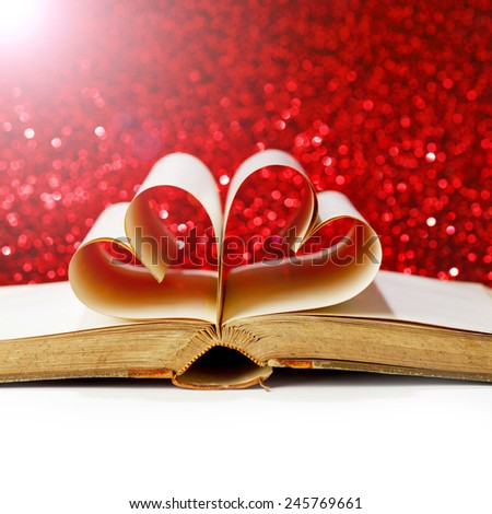 Heart made from book pages, love reading, Valentines day concept - stock photo