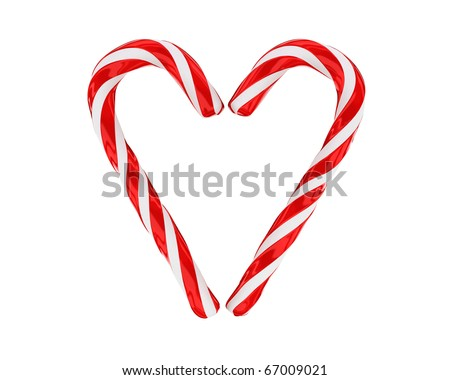 Heart made from christmas candies isolated on white background