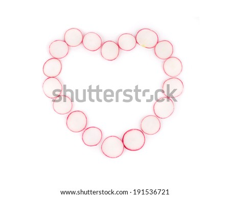 Heart made from red radish. Isolated on a white background. - stock photo