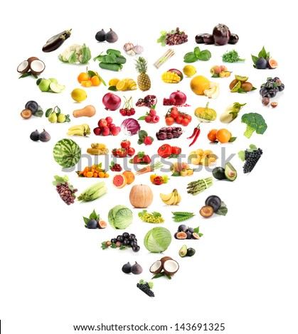 Heart made from various fruits and vegetables isolated on white - stock photo