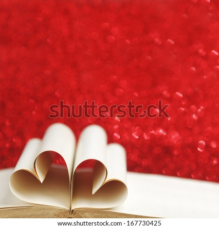 Heart made of blank pages inside a book on glitter background - stock photo