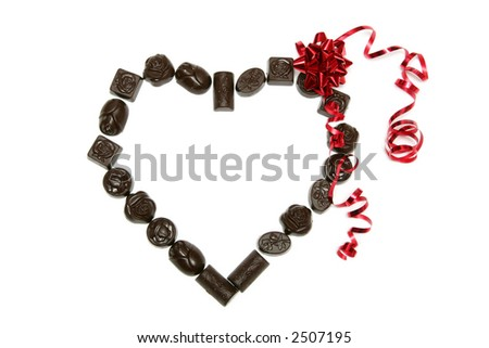 Heart made of chocolates on a white background