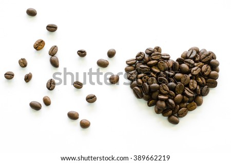 Heart made of coffee beans with wooden spoon on white background, love coffee, coffee beloved, Valentine's coffee