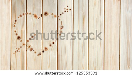 heart made of knots on the pine board - stock photo