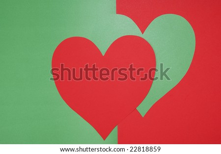 heart made of paper on green background