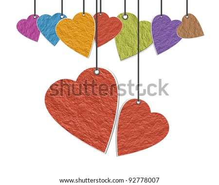Heart made ??of paper with different colors of yarn industry.