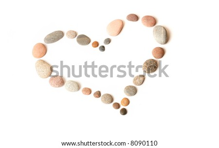 Heart made of pebbles, isolated on white - stock photo