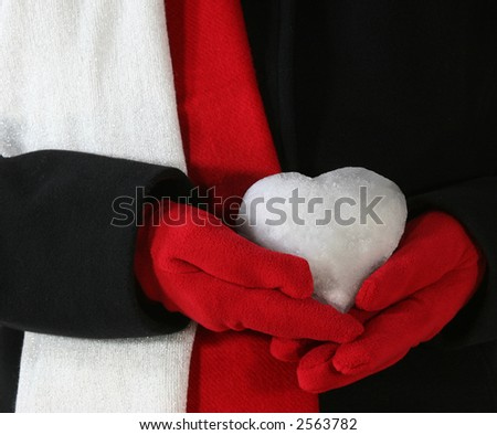 Heart made of Snow on Black Coat, Red Gloves and Red and White Scarfs