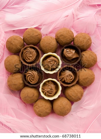 Heart made of truffles and pralines for Valentine's Day. Viewed from above. - stock photo