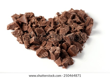 Heart made with pieces of chocolate on white background, valentine's day, selective focus - stock photo