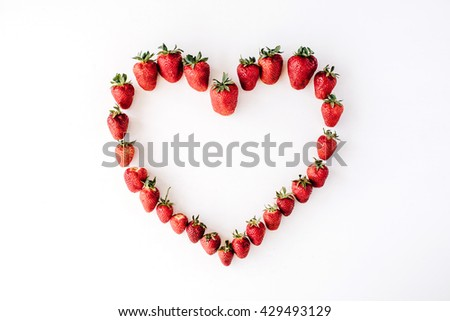heart made with strawberry, flat lay - stock photo