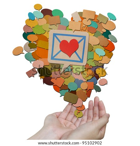 heart messages icons created by recycled paper craft on hands holding - stock photo