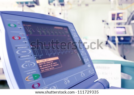 Heart monitor in a hospital room. - stock photo