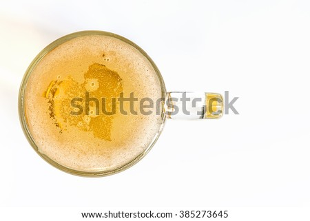 heart of beer bubbles glass of light beer in top view on a white background - stock photo