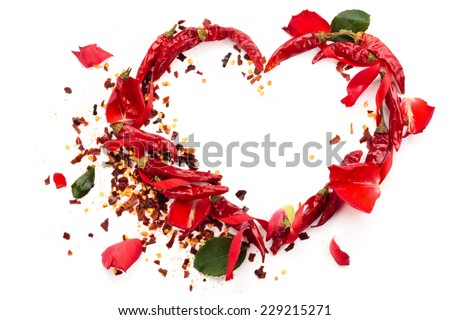 Heart of chili peppers with seed and rose petals. Isolated on white background. - stock photo