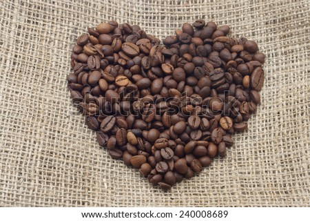 heart of coffee beans on bagging               - stock photo