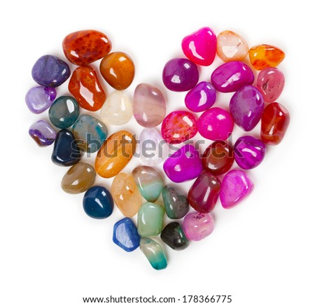 Heart of gems, Heart of stone. Colorful stones and gems arranged in a shape of a heart. - stock photo