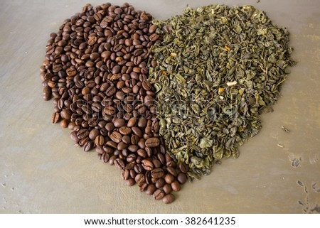 Heart of grains  black coffee and green tea leaves  - stock photo