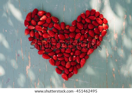 Heart of red sweet strawberries - stock photo